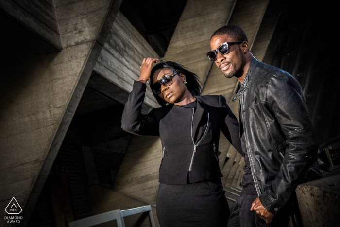 England pre-wedding portraits - industrial concrete architecture provide dramatic backdrop for this lit photo
