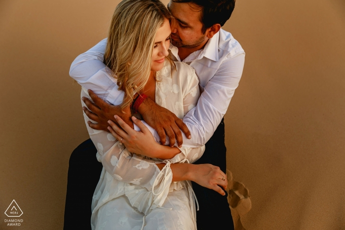 London Engagement Photographer. Warm tone portrait with a warm embrace.