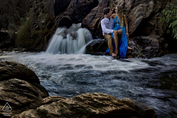 Goias Engagement Photography at a small waterfall with rushing water