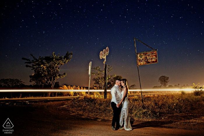 Brazil pre-wedding portraits at night | Long shutter release reveals the headlights of passing cars