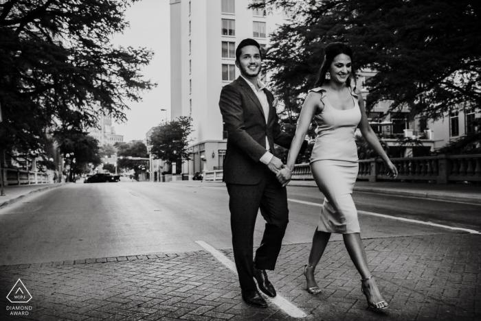 San Antonio couple walks down the stree during their urban portrait session