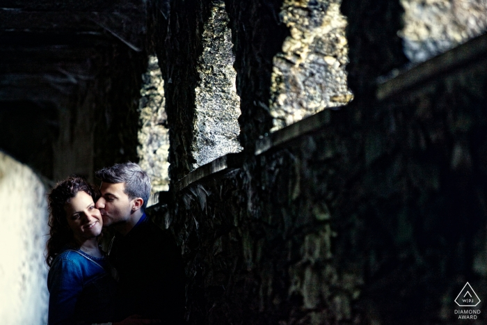 Stone arches create dramatic lighting for this Lombardi engagement portrait
