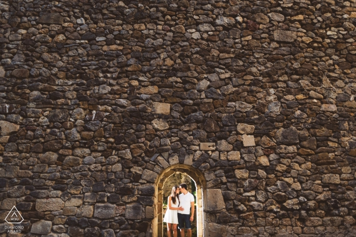Slovenia wedding engagement shoot with a couple in stone archway