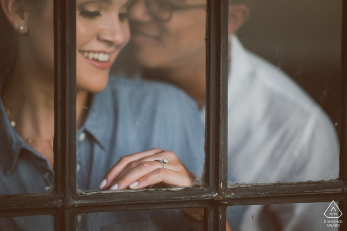 MA pre-wedding engagement pictures of a couple captured through a window | Boston portrait shoot