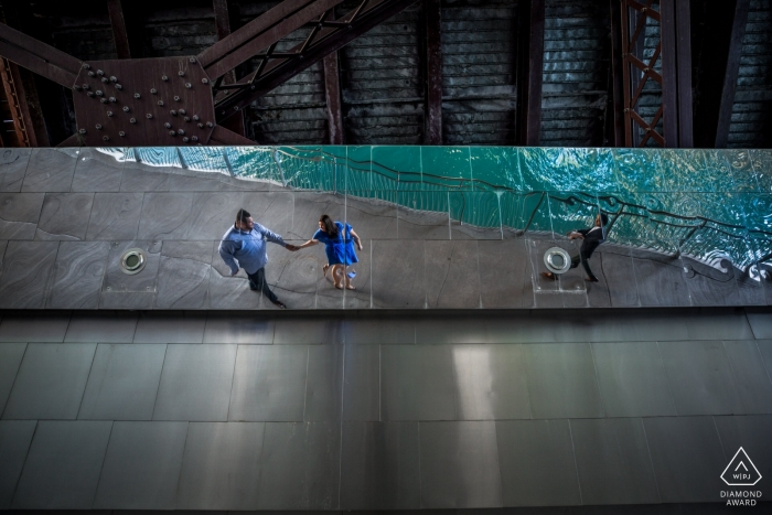 reflection under bridge of this couple in their MN engagement portrait session
