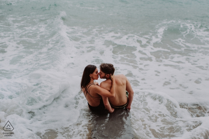 Ocean waves pre-wedding engagement pictures of a couple at the beach | Biscay portrait shoot