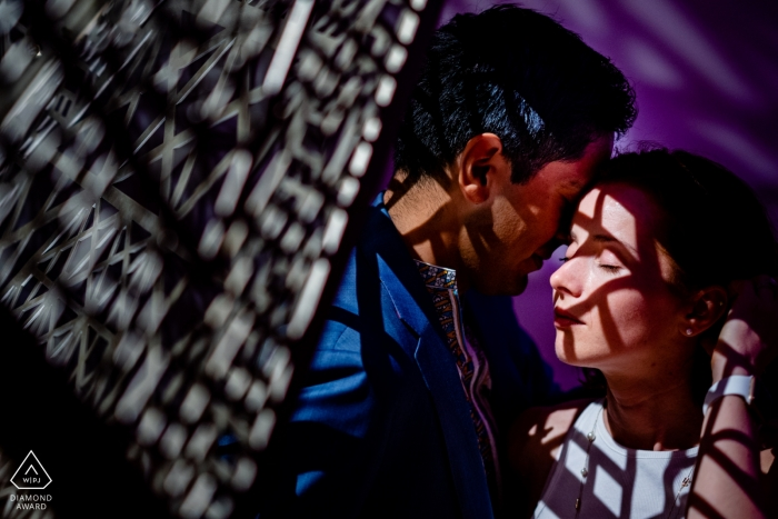 A couple takes a quiet moment with each other in the Renwick Gallery during their engagement portrait shoot e-session