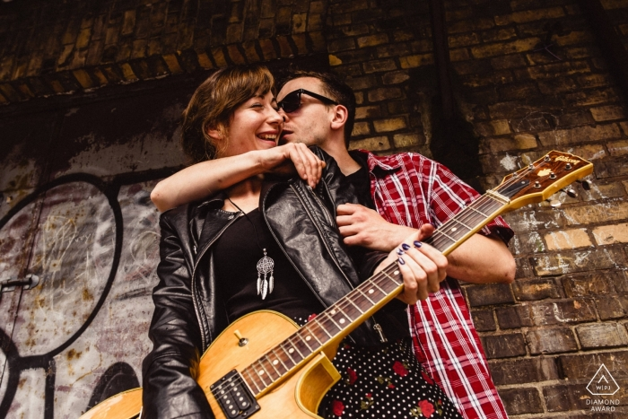 Rock and Roll Engagement Portrait session for this couple with a guitar