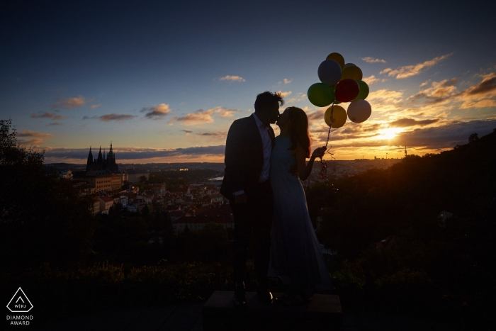 A sunrise Engagement photo session overlooking Prague for this couple holding balloons