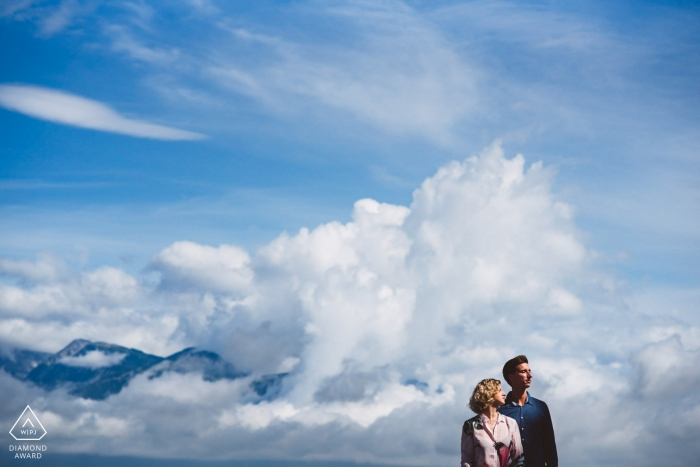 Slovenia wedding photographer | engagement portrait of a couple with their heads in the clouds  | Ljubljana pre-wedding pictures