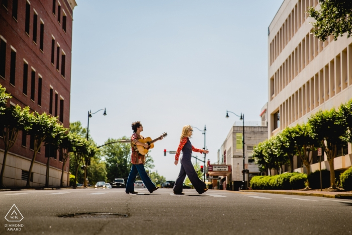 Walking along the street in GA during urban engagement shoot for portraits