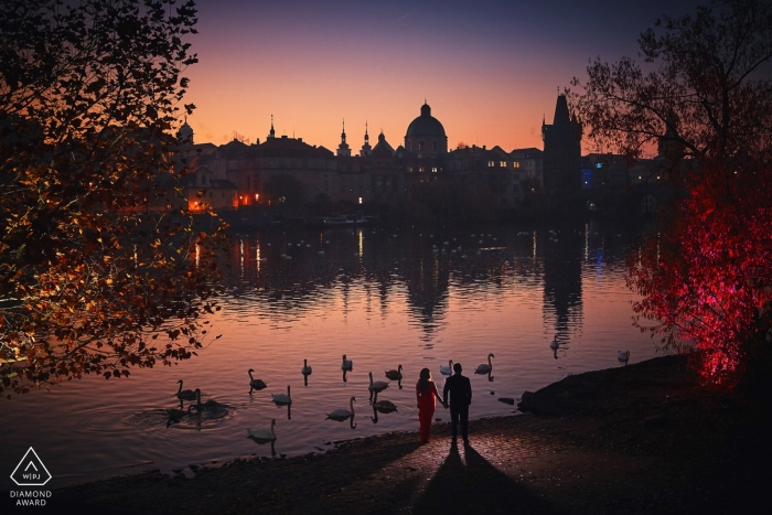 A couple by the riverside | artistic, creative, awesome engagement photos from Prague