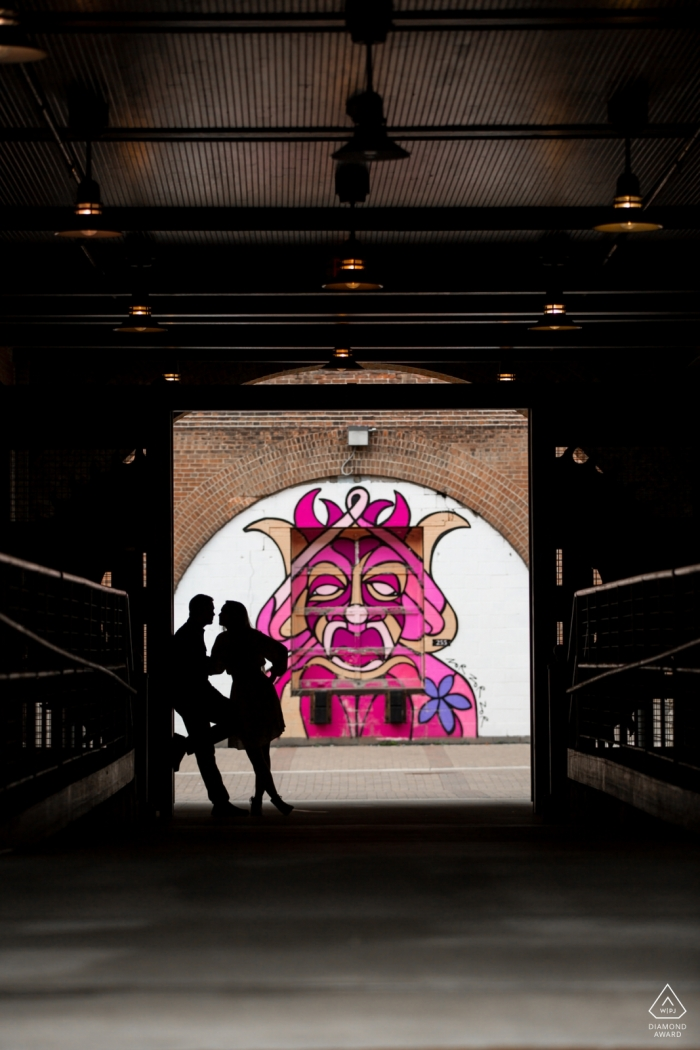 Couple silhouette with queen mural | MN engagement photographer