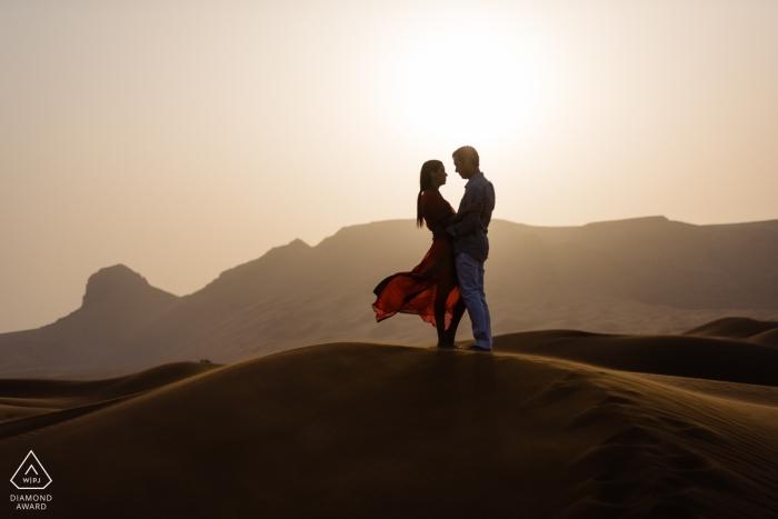 Dubai destination wedding photographer   Desert Sunset engagement session photography in UAE