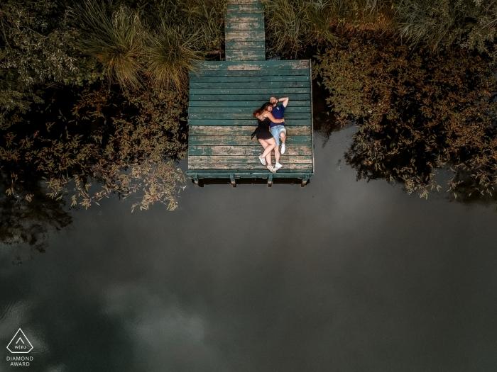 Overhead, drone portrait of couple on boat dock | Séance wedding engagement - France | S'aimer de haut