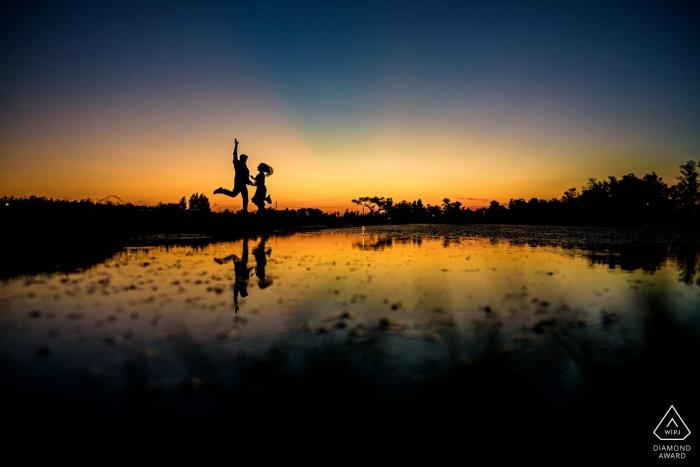 Carcaraña, Argentina Engagement Photo | jump at sunset!