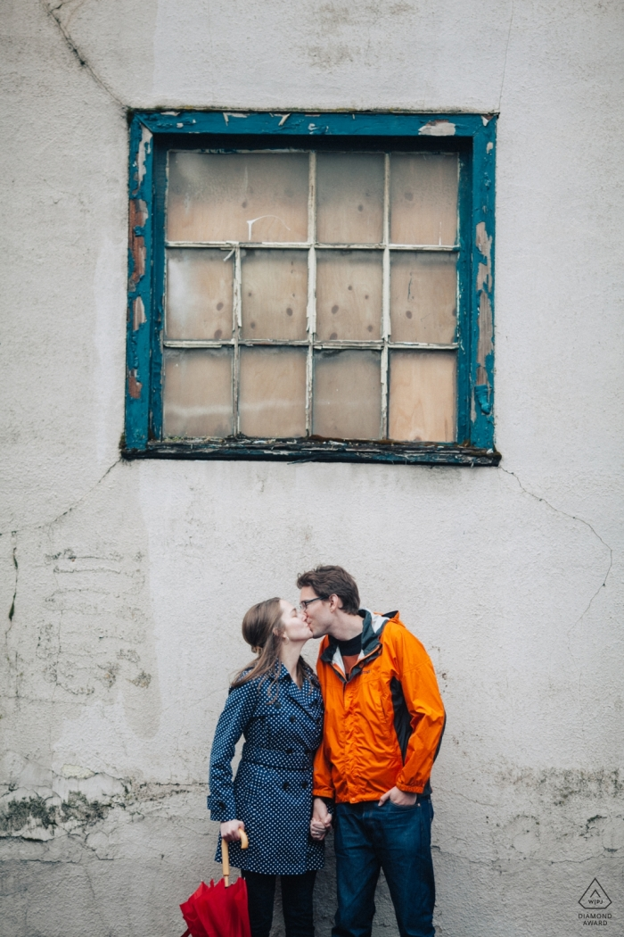 Seattle, WA Couples | Creative Engagement Photography Session with window and wall