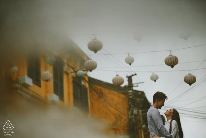 Love with raining in Hoi An by Hoi An photographer | Vietnam Pre Wedding Photo Shoot