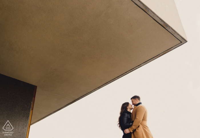 London Pre-Wedding Shoot with Couple in warm colors and architecture