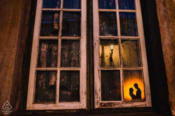 Minas Gerais Engagement Photograph of a couple lit and reflected in glass windows