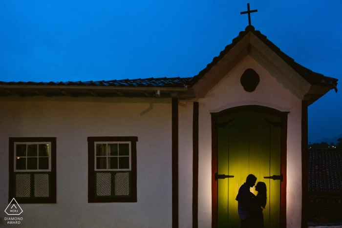 Ouro Preto lit portrait of engaged couple at a church