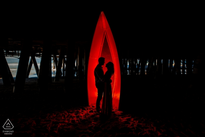 Red Silhouette Under Santa Monica Pier | California Engagement Portrait Photographer