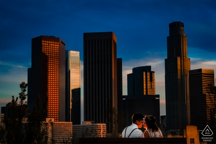 Couple enjoying a romantic sunset in Los Angeles | Romantic Los Angeles Sunset Pre Wedding Portraits