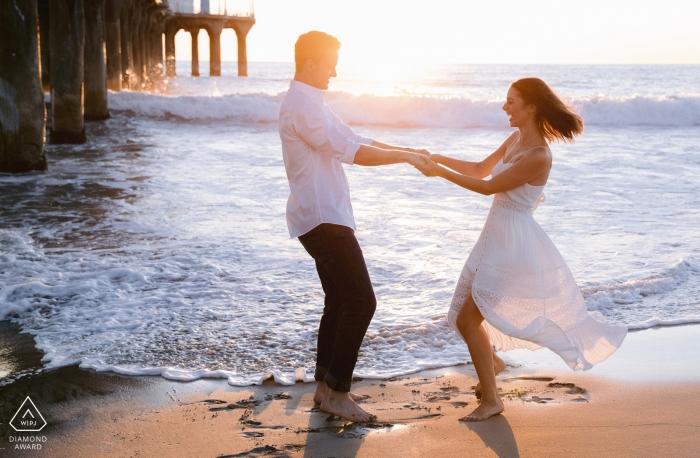 Los Angeles, CA   West coast love at the beach with a pier at sunset   Engagement Photographer