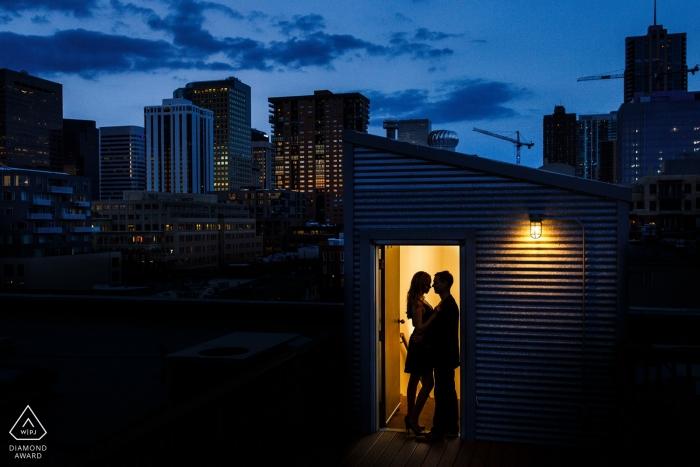 Denver, Colorado Portraits | A silhouette of a beautiful couple against the Denver Skyline at night.