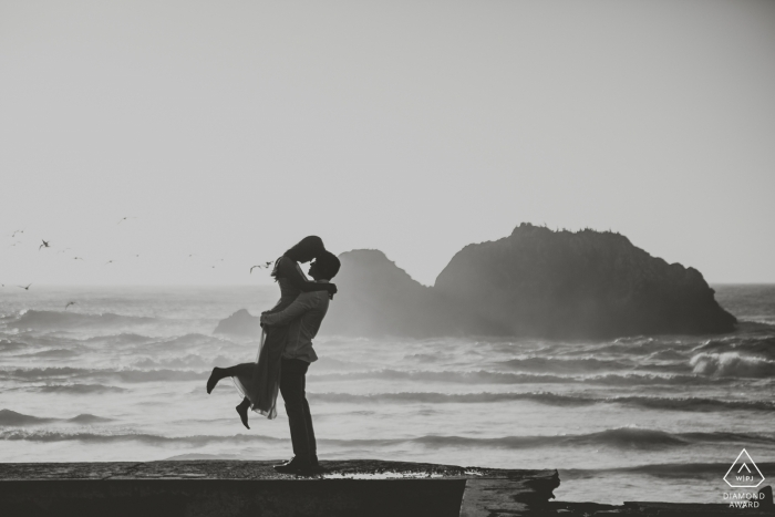 Back lit silhouette portrait of a couple at the beach in black-and-white - San Francisco wedding photographer