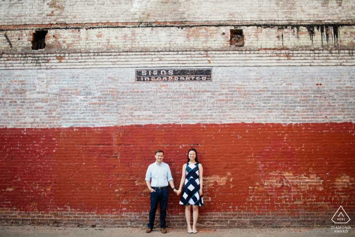 couple in front of red brick wall - Rhode Island Engagement Photographer