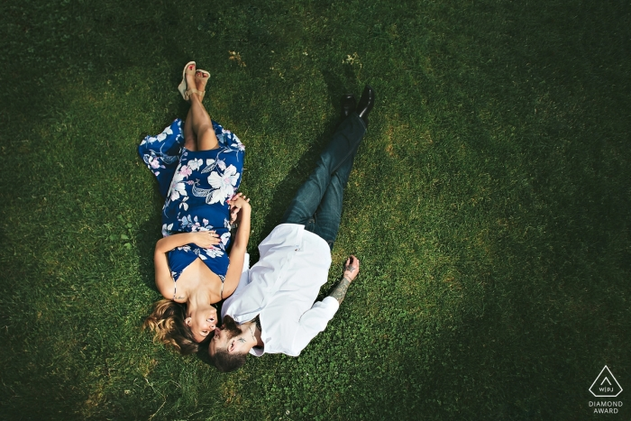 Central Park, NYC engagement portraits - Couple laid down on grass