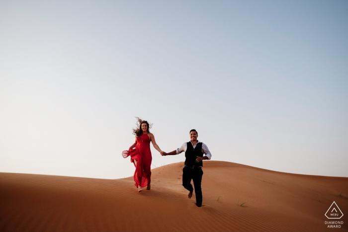 Maleiha Desert, Dubai engagement portrait session - Desert adventure in the sand with a red dress