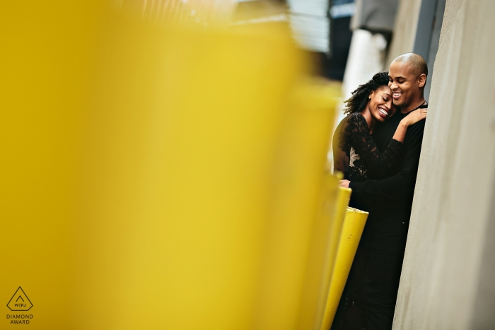 DUMBO couple hugging together during their pre-wedding engagement session