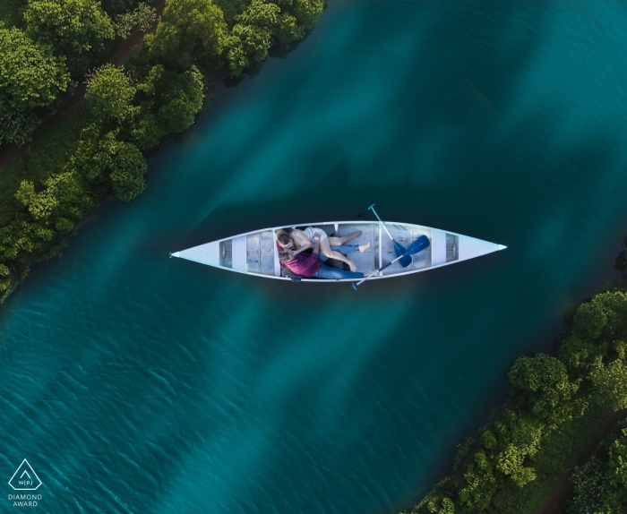 Engagement portrait photos in Key West - Creative Engagement Shoot in a canoe with the drone
