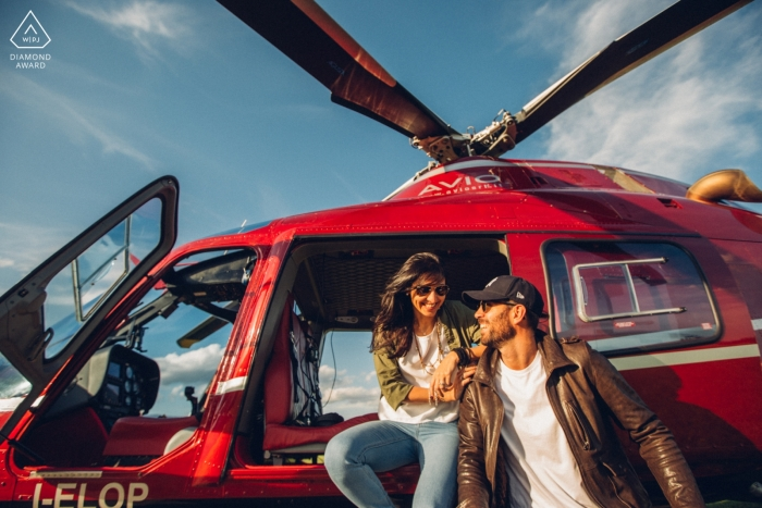 Vicenza pre-wedding portraits of a Couple sitting on red helicopter