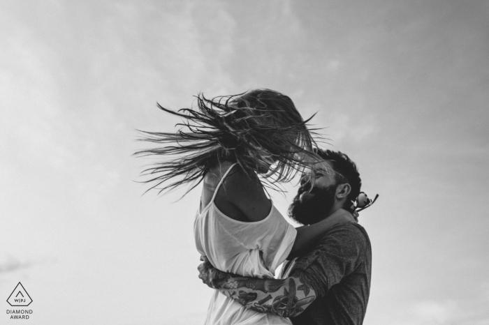 Key West engagement shoot in black-and-white | Up in the Air - let your hair fly in the wind