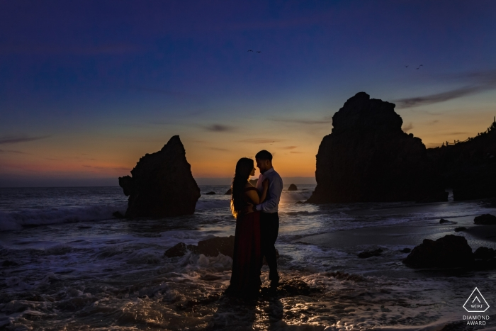 Malibu, California Beach Engagement Photos at sunset in the water