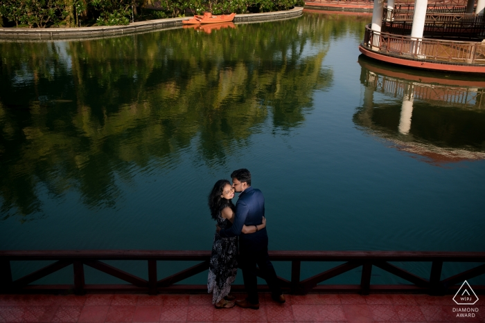 Pondicherry engagement session | higher camera angle overlooking couple and the water