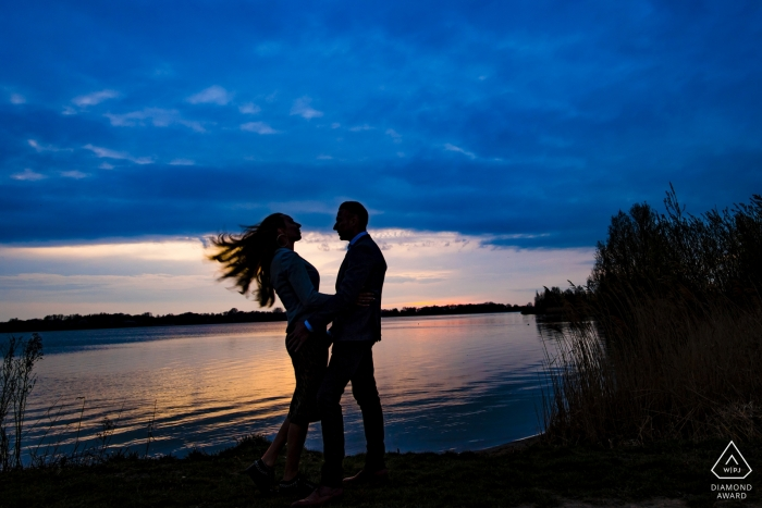 Netherlands engagement photo session at the water with her flying hair