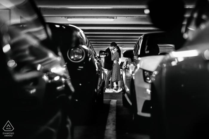 Agen, France Engagement portrait between parked automobiles