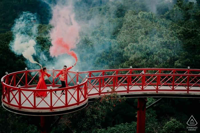 Vietnam Da Lat Engagement Photoshoot with Smoke Grenades on a Red Bridge