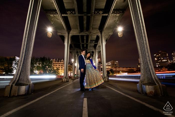 Paris, France Engagement Portrait with light effect with cars under the famous Bir Hakeim Bridge (Inception movie)