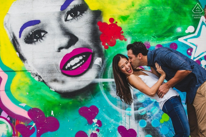 "Asbury Park New Jersey Art Mural Engagement Portrait. Photographer: ""Loved her energy so we used it for an awesome photo."""