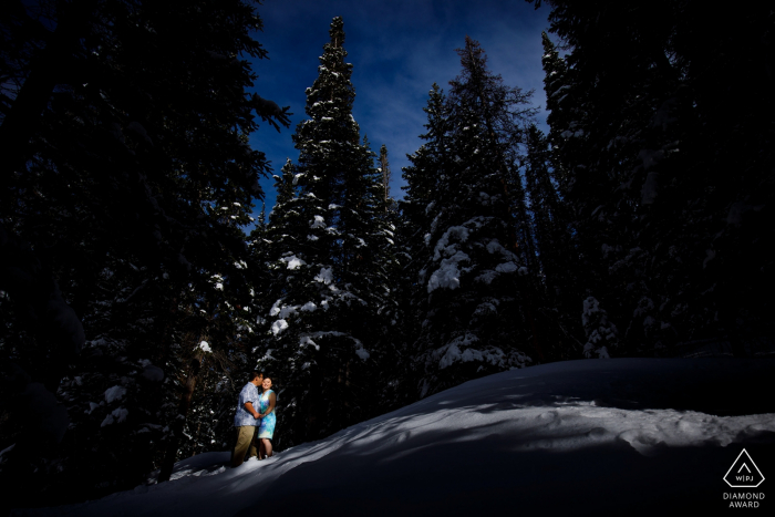 A couple celebrates their engagement at Bear Lake in Rocky Mountain National Park