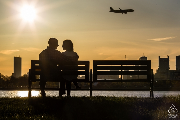 Watching planes go by during their engagement session in Castle Island, South Boston, MA