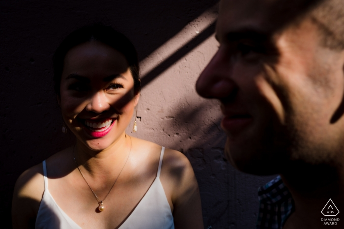 A couple in Saigon can be seen smiling through shadows in this engagement portrait by a Ho Chi Minh, Vietnam photographer.