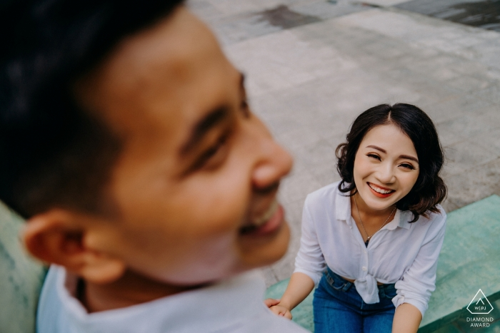 This couple smiles outside during their pre-wedding session in Ho Chi Minh City, Vietnam