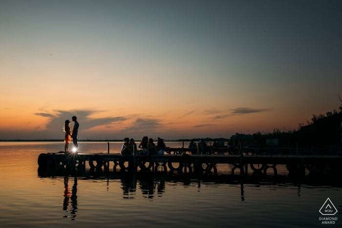Valencia sunset engagement shoot at the water with a light