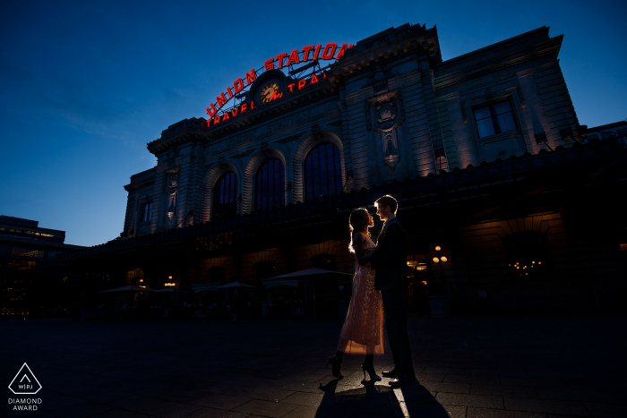 Union Station, Denver, CO - This couple poses together at twilight in front of Denver Union Station during their engagement photos.